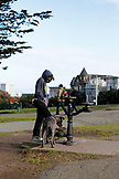 USA, California, San Francisco, NOPA, dog having a drink at Alamo Park