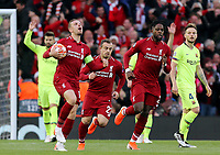Liverpool's Jordan Henderson celebrates after Divock Origi (right) scored the opening goal <br /> <br /> Photographer Rich Linley/CameraSport<br /> <br /> UEFA Champions League Semi-Final 2nd Leg - Liverpool v Barcelona - Tuesday May 7th 2019 - Anfield - Liverpool<br />  <br /> World Copyright &copy; 2018 CameraSport. All rights reserved. 43 Linden Ave. Countesthorpe. Leicester. England. LE8 5PG - Tel: +44 (0) 116 277 4147 - admin@camerasport.com - www.camerasport.com