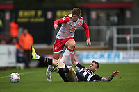 Charlie Carter of Stevenage and Jordan Cook of Grimsby Town during Stevenage vs Grimsby Town, Sky Bet EFL League 2 Football at the Lamex Stadium on 12th October 2019