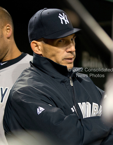 New York Yankees manager Joe Girardi (28) watches twelfth inning action against the Baltimore Orioles at Oriole Park at Camden Yards in Baltimore, MD on Tuesday, April 10, 2012.  The Yankees won the game in 12 innings 5 - 4..Credit: Ron Sachs / CNP.(RESTRICTION: NO New York or New Jersey Newspapers or newspapers within a 75 mile radius of New York City)