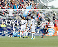 New England Revolution midfielder Diego Fagundez (14) celebrates his score. In a Major League Soccer (MLS) match, the New England Revolution (blue) defeated LA Galaxy (white), 5-0, at Gillette Stadium on June 2, 2013.