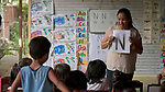 Raquel Fabre, a teacher with the Kapatiran-Kaunlaran Foundation (KKFI), teaches children about the letter N in a KKFI-sponsored preschool in Pulilan, a village in Bulacan, Philippines.<br /> <br /> KKFI is supported by United Methodist Women.