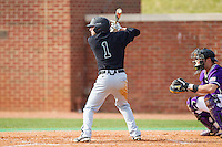 Michael Paez (1) of the Coastal Carolina Chanticleers at bat against the High Point Panthers at Willard Stadium on March 15, 2014 in High Point, North Carolina.  The Chanticleers defeated the Panthers 1-0 in the first game of a double-header.  (Brian Westerholt/Four Seam Images)
