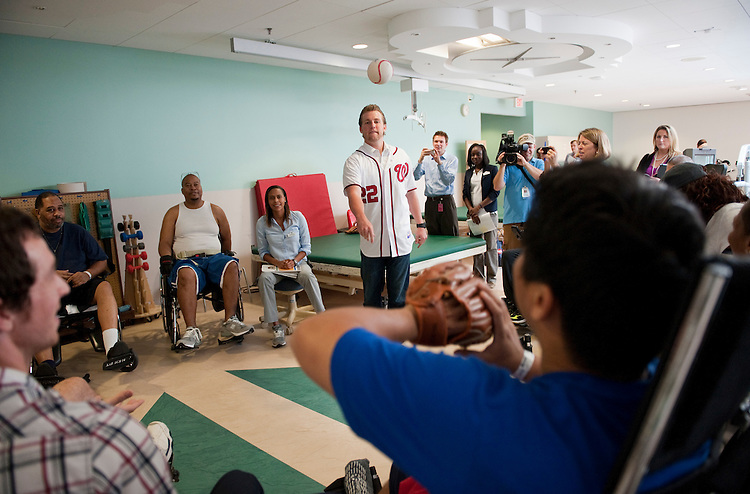 UNITED STATES - AUGUST 19:  Drew Storen, Washington Nationals relief pitcher, talks with patients during a therapeutic recreation group at the National Rehabilitation Hospital.  Storen visited the facility to participate in activities which are often used in patient's rehabilitation.  (Photo By Tom Williams/Roll Call)