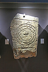 Bronze Age spiral patterns stone tablet in museum, Caceres, Extremadura, Spain