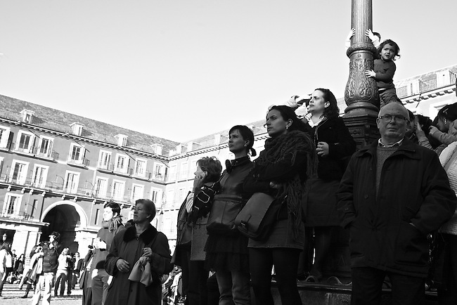 Spectators watch a performance in La Plaza Mayor in Madrid, Spain. Feb. 22, 2009.