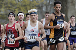 EVANSVILLE, IN - NOVEMBER 18: From left - Greg Beaudette (143) of Indiana University (PA), Alexander Balla (241) of Shippensburg University and William New (30) of American International College compete during the Division II Men's Cross Country Championship held at the Angel Mounds on November 18, 2017 in Evansville, Indiana. (Photo by Tim Broekema/NCAA Photos/NCAA Photos via Getty Images)