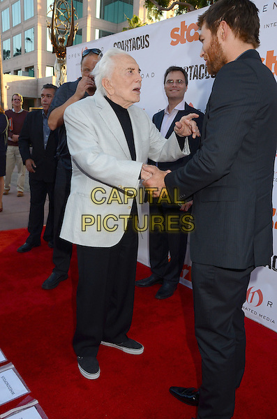 Kirk Douglas, Liam McIntyre.Starz Celebrates Kirk Douglas and the Impact of Spartacus Then and Now held at the Academy of Television Arts & Sciences Goldenson Theater, North Hollywood, California, USA..May 31st, 2012.full length grey gray suit jacket side profile black top shaking hands back behind rear trousers .CAP/ADM/BT.©Birdie Thompson/AdMedia/Capital Pictures.
