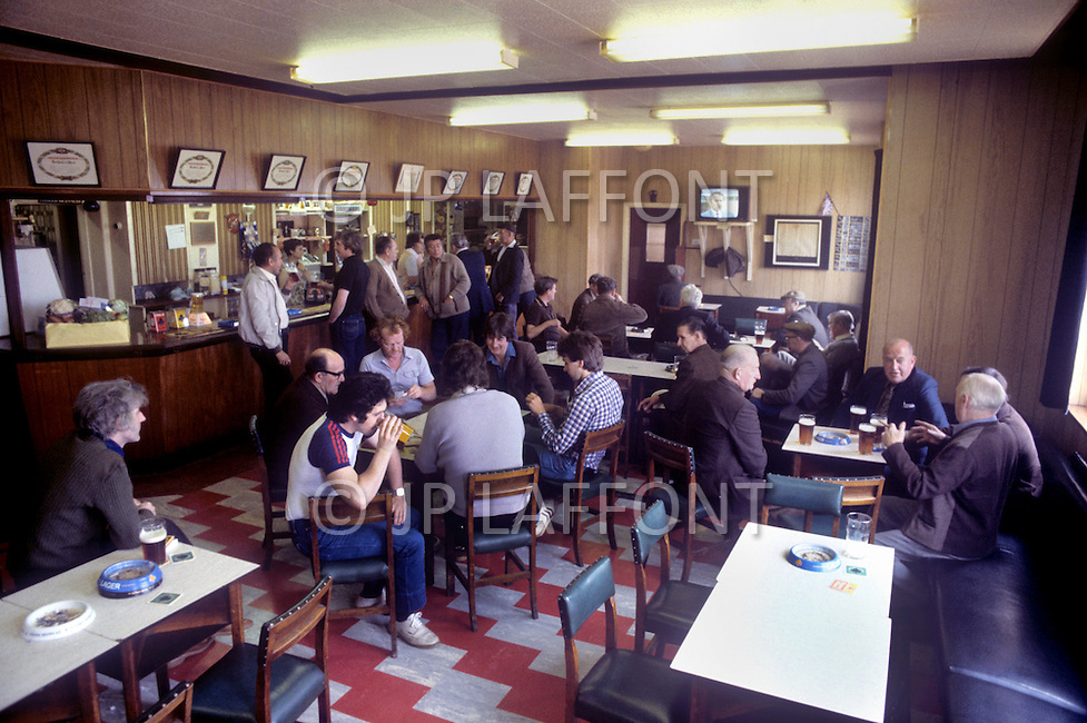 August 1981. Newcastle area, England. The pubs and pool halls are crowded with the unemployed, where they drink beer, play pool and bet on horse races to pass the time.