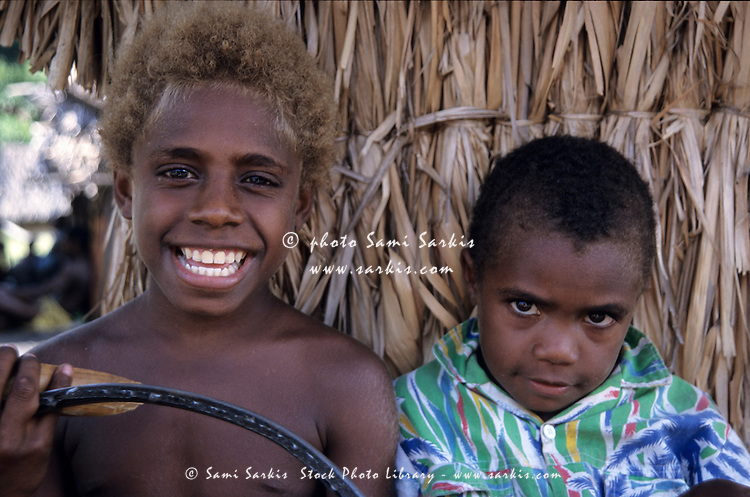 Portrait of two boys standing side by side, Sulphur Bay Village, Ipekel Ipeukel, Tanna Island, Vanuatu.