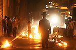 Ultra-Orthodox Jews, most of whom are young children, set garbage cans on fire and block the streets, while they continue to protest against the opening of a parking lot on the Shabbat day of rest, Jerusalem, Tuesday, June 30, 2009. Last Saturday marked the second Sabbath which brought thousands of Ultra-Orthodox Jews into the streets of Jerusalem in violent demonstration. Since Saturday the evenings in the Ultra-Orthodox neighborhoods have been marked with burning garbage cans and general unrest. Photo By: Emil Salman / JINI