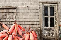Coastal shanty and bouys, Maine, USA
