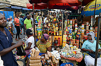 TOGO, Lome, Grande Marche, Grand market, women sell imported duty free liqueur / Grosser Markt, Marktfrauen