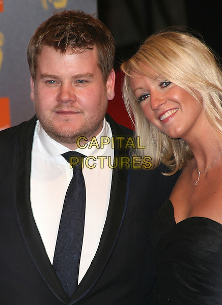 JAMES CORDEN & JULIA CAREY.Arrivals at the Orange British Academy Film Awards 2010 at the Royal Opera House, Covent Garden, London, England..February 21st, 2010.BAFTA BAFTAs half length black  stubble facial hair strapless suit tie couple .CAP/JIL.©Jill Mayhew/Capital Pictures