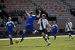 Home captain Dougie Gair battles for the ball before opening the scoring in the Scottish pyramid play-off second leg between Edinburgh City (in white) and Cove Rangers at the Commonwealth Stadium at Meadowbank in Edinburgh. The match between the champions of the Lowland and Highland Leagues determined which club would play-off against East Stirlingshire for a place in the Scottish league. The second leg ended 1-1, giving Edinburgh City a 4-1 aggregate win.