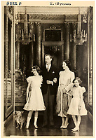 BNPS.co.uk (01202 558833)<br /> Pic: MarcusAdams/ChiswickAuctions/BNPS<br /> <br /> The Royal family at Buckingham Palace on the eve of WW2 - (Princess Elizabeth aged 13)<br /> <br /> Charming childhood photos of Princess Elizabeth and Princess Margaret have come to light, including a previously unseen image of the future Queen in a kilt.<br /> <br /> The portraits, taken by acclaimed British society photographer Marcus Adams, capture the future Queen from being a baby to her adolescence.<br /> <br /> The Queen Mother would often take her daughters to his central London studio where he would set up toys and props to keep them entertained