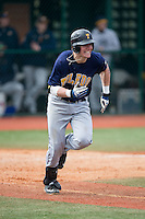 Tyler Baar (23) of the Toledo Rockets hustles down the first base line against the Virginia Tech Hokies at The Ripken Experience on February 28, 2015 in Myrtle Beach, South Carolina.  The Hokies defeated the Rockets 1-0 in 10 innings.  (Brian Westerholt/Four Seam Images)