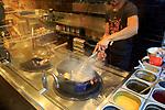 Show cooking fast food wok display at restaurant, Wok to Walk, Calle Mayor, Madrid, Spain