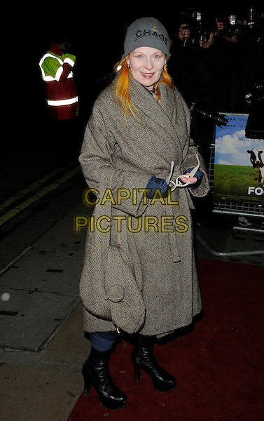 """DAME VIVIENNE WESTWOOD .The """"Food Inc"""" VIP screening, Curzon Mayfair cinema, London, England..February 8th, 2010.full length beige grey gray coat jacket black platform boots hat beanie bag purse chaos .CAP/CAN.©Can Nguyen/Capital Pictures."""