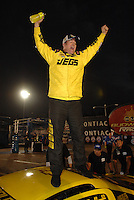 Nov 4, 2007; Pomona, CA, USA; NHRA pro stock driver Jeg Coughlin Jr celebrates after winning the Auto Club Finals and the 2007 pro stock championship at Auto Club Raceway at Pomona. Mandatory Credit: Mark J. Rebilas-US PRESSWIRE