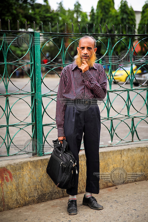 'My grandfather did it, my father did it and now I am doing it. All older Muslim people love to practice this generation after generation' - Mohammad Alam.<br /> <br /> It is very common in Bangladesh to see older people with dyed orange hair, men with orange beards or orange moustaches and women with orange hair. The dye used is from the flowering Henna plant. The practice comes from the widely held belief that the Prophet Muhammad dyed his beard and hair. It is also common among people returning from Hajj. Some Muslims believe that henna is the only dye they are free to use for colouring their hair.