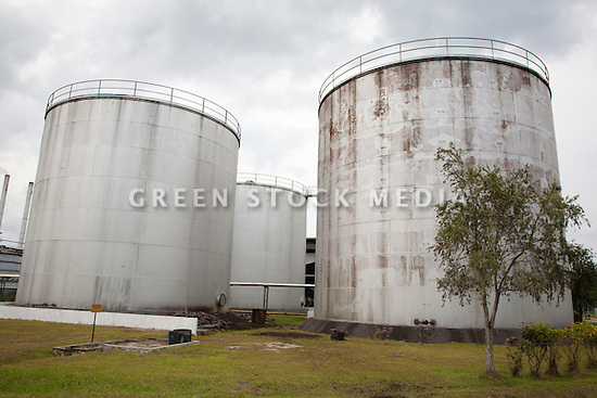 Storage container for palm oil crude. The Sindora Palm Oil Mill owned by Kulim & Crude Palm Oil Storage Containers Malaysia Southeast Asia | Green ...
