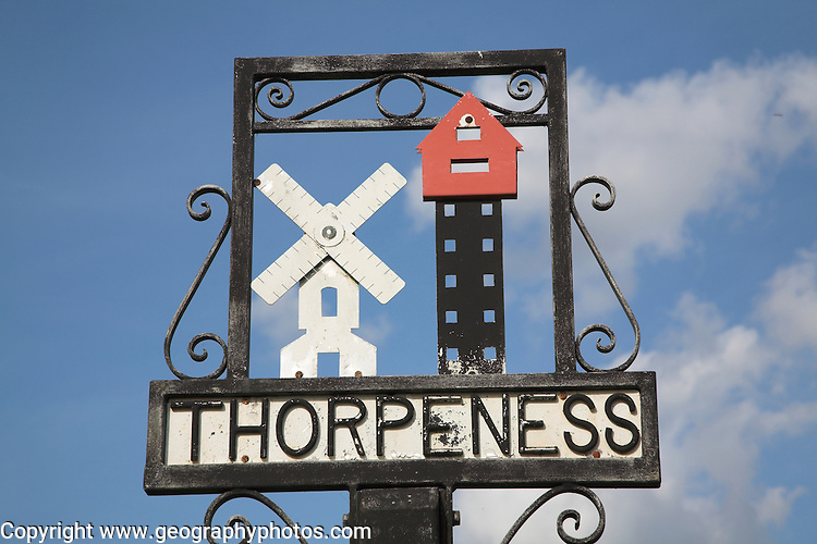 Thorpeness village sign showing the House in the Clouds and windmill, Suffolk, England