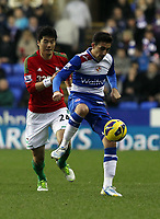 Wednesday 26 December 2012<br /> Pictured: Ki Sung-Yueng (L).<br /> Re: Barclays Premier League, Reading v Swansea City FC at the Madejski Stadium, Reading, Berkshire.