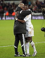 Swansea manager Alan Curtis celebrates his team's win with Modou Barrow after the Barclays Premier League match between Swansea City and Watford at the Liberty Stadium, Swansea on January 18 2016