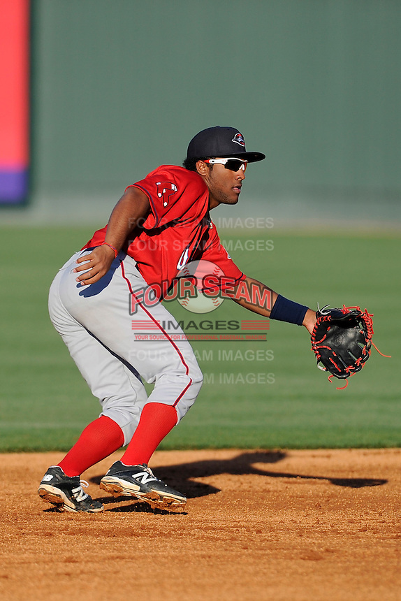 Infielder/second baseman Wendell Rijo (11) of the Greenville Drive works out on the team's Media Day first workout on Tuesday, April 1, 2014, at Fluor Field at the West End in Greenville, South Carolina. Rijo is the Boston Red Sox No. 18 prospect, according to Baseball America. (Tom Priddy/Four Seam Images)