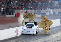 Oct 30, 2015; Las Vegas, NV, USA; NHRA funny car driver Tim Gibbons hits the wall during qualifying for the Toyota Nationals at The Strip at Las Vegas Motor Speedway. Mandatory Credit: Mark J. Rebilas-USA TODAY Sports