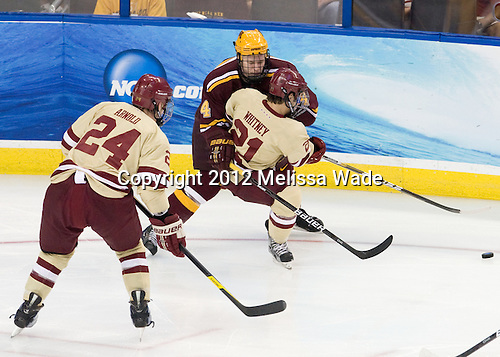 Bill Arnold (BC - 24), Steven Whitney (BC - 21), Seth Helgeson (Minnesota - 4) - The Boston College Eagles defeated the University of Minnesota Golden Gophers 6-1 in their 2012 Frozen Four semi-final on Thursday, April 5, 2012, at the Tampa Bay Times Forum in Tampa, Florida.