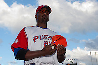 11 March 2009: #21 Carlos Delgado of Puerto Rico gets back to the dugout after the national anthem during the 2009 World Baseball Classic Pool D game 6 at Hiram Bithorn Stadium in San Juan, Puerto Rico. Puerto Rico wins 5-0 over the Netherlands