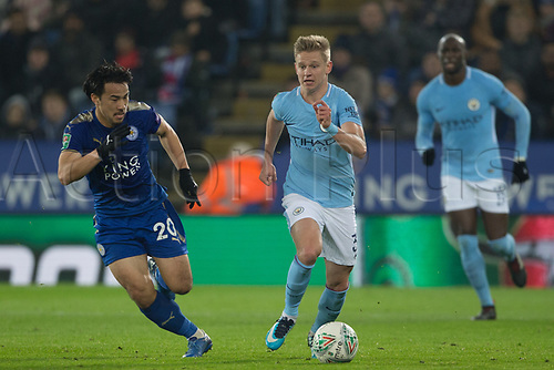 19th December 2017, King Power Stadium, Leicester, England; Carabao Cup quarter-final, Leicester City versus Manchester City; Oleksandr Zinchenko of Manchester City breaks free of Shinji Okazaki of Leicester City