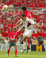 Landon Donovan leaps for a header. The USA tied South Korea, 1-1, during the FIFA World Cup 2002 in Daegu, Korea.