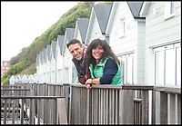 BNPS.co.uk (01202 558833)<br /> Pic : RogerArbon/BNPS<br /> <br /> Paul and Jo Oldridge from the New Forest who rent one of the lodges.<br /> <br /> Upwardly Mobile - Could these two storey luxury beach lodges could spell the end for the humble British beach hut?<br /> <br /> The days of the simplistic wooden beach hut appear to be in the past after a row of luxurious new cabins were unveiled on the south coast.<br /> <br /> The 24 overnight lodges have been opened in Bournemouth, Dorset and are available to rent for an eye-watering £700 for a four night stay.<br /> <br /> The chalets have room to sleep four adults and two children as well as their own private kitchens, toilets and shower facilities.