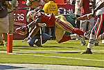 San Francisco 49ers running back Garrison Hearst (20) dives but falls short of making touchdown on Sunday, September 7, 2003, in San Francisco, California. The 49ers defeated the Bears 47-7.