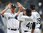 Seattle Mariners' pitcher Charlie Furbush high fives Danny Farquhar  during introductions before their game against theLos Angeles Angels in the  season home opener April 6, 2015 at Safeco Field in Seattle.  The Mariners beat the Angels 4-1.       ©2015. Jim Bryant Photo. ALL RIGHTS RESERVED.