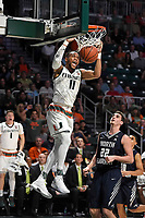 CORAL GABLES, FL - NOVEMBER 25:  Miami guard Bruce Brown, Jr. (11) reacts with joy after scoring a basket in the second half with UNF forward Trip Day (22) looking on as the University of Miami Hurricanes defeated the University of North Florida Ospreys, 86-65, on November 25, 2017, at Watsco Center in Coral Gables, Florida. (Photo by Samuel Lewis/Icon Sportswire)