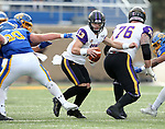 BROOKINGS, SD - NOVEMBER 16: Will McElvain #13 of the Northern Iowa Panthers escapes the grasp of Ryan Earith #90 of the South Dakota State Jackrabbits during their game Saturday afternoon at Dana J. Dykhouse Stadium in Brookings, SD. (Photo by Dave Eggen/Inertia)