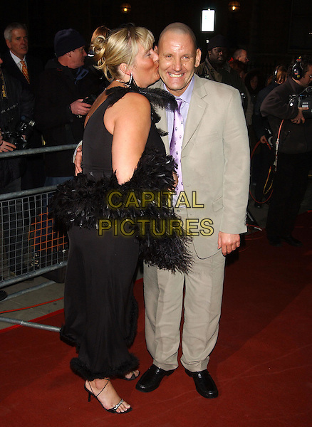 MICHELLE & BARRY -  WIFE SWAP.National Television Awards Party of the Year.Royal Opera House, Covent Garden, London.7 December 2003.feather boa, kissing.sales@capitalpictures.com.www.capitalpictures.com.©Capital Pictures