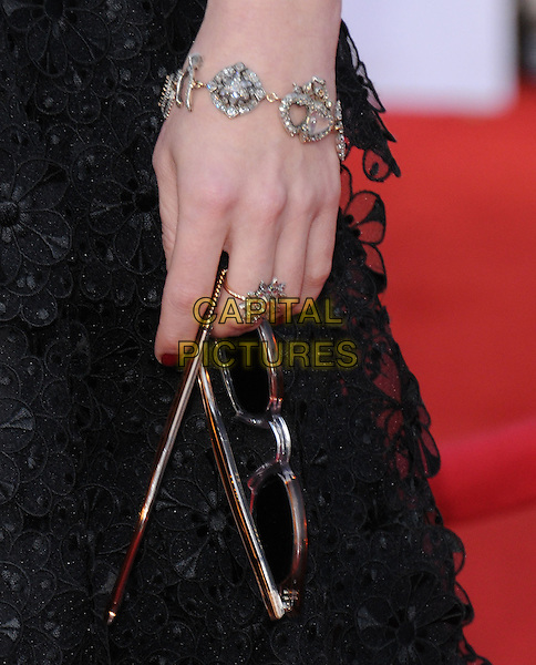 HELENA BONHAM CARTER's hand .at the 17th Screen Actors Guild Awards held at The Shrine Auditorium in Los Angeles, California, USA, .January 30th 2011..SAG Sags arrivals detail bracelet ring holding glasses  .CAP/RKE/DVS.©DVS/RockinExposures/Capital Pictures.