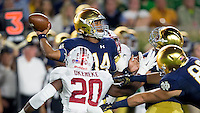 Quarterback DeShone Kizer (14) throws under pressure in the first quarter.
