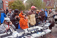 New York, NY -  2 November 2012 Residents of Lower Manhattan charge cell phones, laptops and iPads from an electric generator in Union Square Park, in the aftermath of Hurricane Sandy. Multiple power strips allowed up to about 100 devices to charge at the same time. At&t custoers were able to access cell phone coverage which had been down in Lower Manhattan during the blackout.