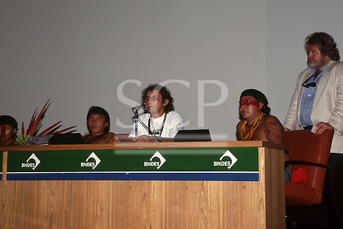 United Nations Conference on the Environment and Development, Rio de Janeiro, 1992. Gomercindo Rodrigues (speaking), Davi Yanomami and Darrel Posey at the Earth Parliament.