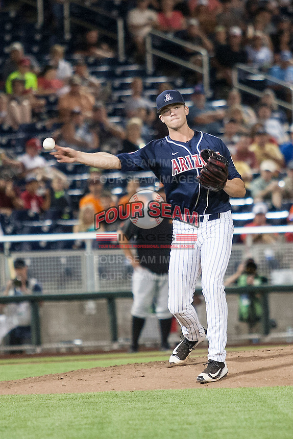 Arizona Wildcats pitcher Bobby Dalbec (3) makes a throw to first base against the Oklahoma State Cowboys in Game 6 of the NCAA College World Series on June 20, 2016 at TD Ameritrade Park in Omaha, Nebraska. Oklahoma State defeated Arizona 1-0. (Andrew Woolley/Four Seam Images)