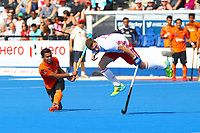 Englands Harry Martin attempts to block a shot from Malaysia's Izad Jamaluddin during the Hockey World League Semi-Final Pool A match between England and Malaysia at the Olympic Park, London, England on 17 June 2017. Photo by Steve McCarthy.