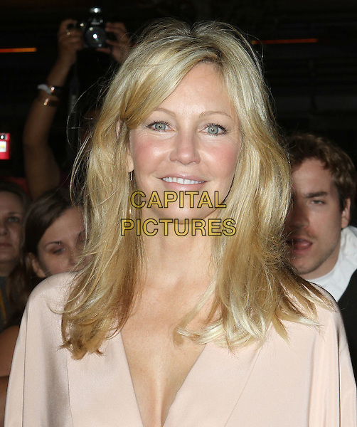"Heather Locklear.""The Twilight Saga: Breaking Dawn Part 1"" Los Angeles Premiere Held At The Nokia Theatre L.A. Live, Los Angeles, California, USA, 14th November 2011..portrait headshot smiling  skin wrinkles crows feet peach beige top  .CAP/ADM/KB.©Kevan Brooks/AdMedia/Capital Pictures."