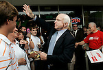 John McCain shakes hands with supporters while on a lunch stop at the Whole Hog Cafe in Little Rock, Arkansas Friday, April 25, 2008.