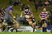 Sootala Fa'asoo'o gets tackled by Kieran Read. The game of Three Halves, a pre-season warm-up game between the Counties Manukau Steelers, Northland and the All Blacks, played at ECOLight Stadium, Pukekohe, on Friday August 12th 2016. Photo by Richard Spranger.